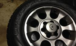 Five total tires for sale, 4 barely used Yokohama Geolandar H/T-S tires, you can still see the spokes. The tires are off of a Toyota FJ Cruiser and has the alloy rims that came with the vehicle. I am including the spare tire wich is a matching size Dunlop