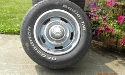4 Chevy Rally tires, straight rims ( painted Baby Blue ) with hubs and centers.