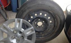 Four Nissan factory rims w decent tires. $100 for all four. Must haul P215/60R16. Make offer