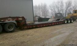 "2000 Rogers 50 Ton, tri-axle low bed, 49' long, 8.5' wide, 26"" deck height"