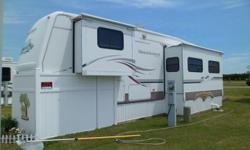 Very nice Located on WHITE Oak River. 5th wheel camper located at White Oak Shores Campground near Emerald Isle and Swansboro permanent site Lot J 13. Large deck and storage under 5th wheel and golf cart ramp. 2 slideouts. Master bedroom has queen size