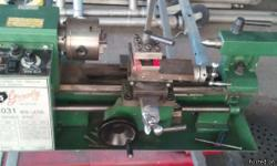 Grizzly 7x10 mini metal lathe. Includes 3-jaw chuck, tailstock, dead center for tailstock, 4-way toolpost with two carbide cutters. What's in the pictures is what there is.