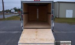Stock #: custom order Serial #:order Description ::: the standard features are not too bad either!!! They include: 1.) Thermacool lined ceiling 2.) V-nose w/ solid wall construction 3.) Rear ramp door w/ spring assist 4.) Rv flush lock w/ keys on 32? side