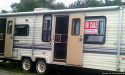 91 COACHMAN TRAVEL TRAILER . 27 FOOTER, DUAL AXLE HAS AN ELECTRIC FRIDGE, GAS WATER HEATER AND FURNACE, NEWER ROOF A/C, FULL SHOWER, FULL BATH , FULL AWNING, 2 ENTRANCES. FRESH SILICONE ON ONE PIECE ROOF 2 YEARS AGO. MAGIC CHEF STOVE; VERY CLEAN INSIDE