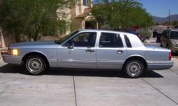 1991 Lincoln Town Car (Cartier Edition), runs excellent, looks excellent inside/out, no exterior or mechanical problems, A/C (blows cold!), power everything, 150K.