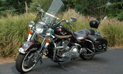 Always garaged HD Road King. Leather bags, detachable winshief, has full 95th anniversary cover.