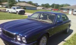 Beautiful blue jag ...Tons of bells and whistles. .BUY FPR PARTS OR RIDE IN STYLE..THOUSANDS ON NEW PARTS ...6 month old Good year tires...not even worn. Check light came on . Parked imm...have receipts for at least 10000 In the past year to make it run