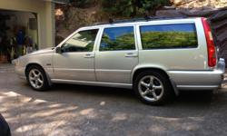 "Silver, all wheel drive with leather interior. Has roof rack, with cargo carrier & bike rack.  One owner & just passed Smog inspection. Good working condition with some minor ""dings"" Heating, air conditioning and radio/CD works well"