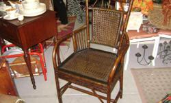 Pier one Bamboo chair. Excellent condition. Great accent piece or desk chair. Located in historic Seminole Heights 4709 N. Florida Ave. (corner of Fl/Osborne) Tampa, Fl 33603 -- Hours 11ish - 6 Tuesday - Friday 11ish - 4 Saturday 12ish - 4 Sunday