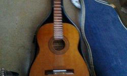 This is a beautiful, mahagony acoustic guitar in excellent playing condition with pristine guitar case and a few pieces of sheet music, also has an electric tuner.  This guitar has been handled with great care and is in GREAT condition.  Comes