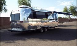 """Airstream was purchased in 1999 new.The """"Safari"""" model has full solid oak interior in immaculate condition. Airstream is better than new: oak flooring replaced original carpet; tires with just over 7,000 miles"""