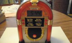 Alarm Clock, Shape of Miniature Juke Box, very good condition, also plays some British songs, by Beatles.