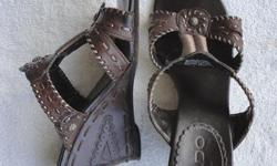 Originally $25 +/- Barely worn. No marks, scratches or tears. Decorative embossing on heels. Size 7.5 Will negotiate.