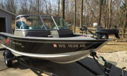 2008 Dominator Sport 90 HP Mercury Optimax with power trim and tilt and a transom support, a 9.9 Mercury kicker , 24 volt Minnkota bow mount trolling motor with auto pilot and quick release mount, live well and bait wells, rod locker with room for 8 rods,