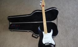 beautiful fender stratocaster guitar american made in excelent condition twenty years on age slitly used with hard case and nice amp and sound box all for $1300.00 with free distortion pedal.call Abe @()-