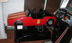 Arcade coin operated amusement kiddie car ride, red, horn, lights, takes quarters, exc. condition. $350.00.  Call Joe --.