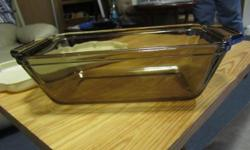 Nice heavy Anchor Hocking amber glass loaf pan with plastic cover. In terrific condition. Measures 9 x 5.25 x 2.75 inches.