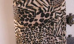 ANIMAL PRINT WRAP SKIRT Pre-Owned Size: Medium Polyester and Spandex Made by Eye Candy 30 inches excluding the ties Each tie is 22 inches long Total waist measurement with ties is 52 inches Length of skirt measurement taken from the waist to the bottom of
