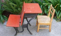 Cute primary red school desk with chair.