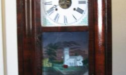 "Approx. Circa. 1874 Antique Wall Clock, Front says ""Greenwood Cemetery Entrance"" with key."