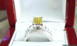 LADIES YELLOW AND WHITE DIAMOND RING SET IN WHITE GOLD