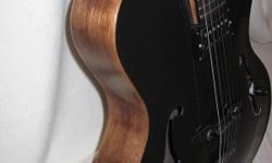 Hello, I have a 2004 clean jazz guitar ....an archtop ....made in very good tone with a rounded cutaway shaped body Alnico humbucker pick-up on-board great tone through the amp....walnut back and sides with a spruce top ebony fretboard walnut neck Joe 310