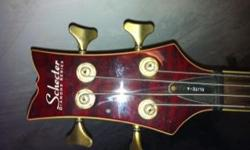 beautiful original schecler bass in perfect condition, also i have other instruments guitars, drums and more call me 256-3552226