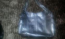 This silvery,shiney purse is in mint condition. Barely used. It is worth well over asking price.