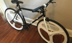 """Brand new black and white Fuji-Oval Concepts bicycle: steel frame, one speed, ridden once, comes with kryptonite u-bolt lock with extra key, as well as lights. 24"""" $500 OBO! Needs to go ASAP!!!"""