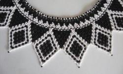 """This necklace is about 15""""long from clasp to clasp (at smallest measurement around the neck) x 3"""" wide at the widest points. It is a stunning piece that is black and white seed bead collar in diamond and triangle pattern with hook and eye closure. It is"""