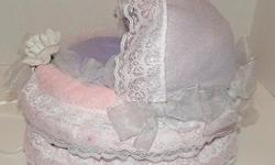 Baby diaper Bassinet cradle baby shower gift centerpiece Cake contains: 40-45 size 1 pampers diapers 1 fleece blanket 1 receiving blanket 2 wash clothes 1 onsie Available for shipping or local pick up or delivery