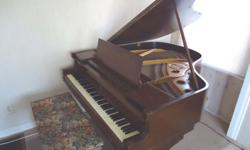 Taber Baby Grand Piano, dark brown with bench. Plays and sounds beautiful.