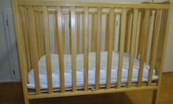 Wooden Natural Color Port-A-Crib includes original and UPGRADED mattress AND bumper guard (pink) Only 4 month old, excellent conditon! Also available:  Folding Highchair $40 Delux Changing Pad $25 Pack/Play (used) (extra sheets) $25