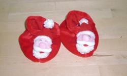 Adorable pair of Santa slippers, size 12-18 months. In like new condition. Slippers and soles are in perfect shape.