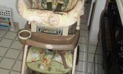 WINNIE THE POOH STROLLER AND CAR SEAT.