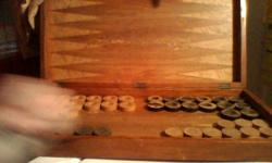 THIS WAS MY GREAT GRANDPA'S GAME. IT ISNT MISSING ANY PIECES. I DONT KNOW WHAT ITS WORTH, MAKE ME AN OFFER!! THANK YOU.