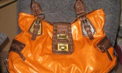 view at: http://www.ebay.com/sch/Womens-Handbags-Bags-/169291/m.html?_nkw=&_armrs=1&_ipg=&_from=&_dmd=2&_ssn=sargentslasherstoys           Orange and Brown Handles Diophy Handbag   My Profile Check out my other listings View