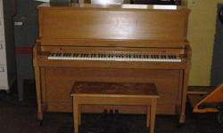 THIS IS A BEAUTIFUL BALDWIN STUDIO PIANO - PROFESSIONAL SIZE 45 inches tall  Honey oak finish - great condition - can help