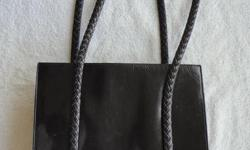 """Original owner. Originally approx $250. Bally, black, approx 12""""x14"""", leather handbag. Heavy duty zippers inside pockets. No scratches, rips or tears. Condition like new."""