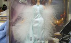 "Barbie 2000 Collector Edition Second in a Series Hollywood Movie Star. 12"" Tall. Barbie in Between Takes with Long Flowing Aqua Charmeuse, Chiffon Negligee, Marabou Stole, Shoes, Doll Stand. New in Box. Please Call Sue or Karl at 1---."
