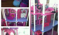 barbie house!!! just bought last xmas for my daughter. great shape, only a few months old. 3 story's tall. paid $280 for it. comes with 2 cars, some furniture, working accessories. shower makes noise,doorbell works. fairplace lights up. tv pops up. lots