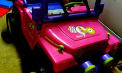 Barbie Jeep for sell. Battery and charger included. Working Fm Radio