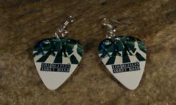 Beatle's guitar pick earrings made with real guitar picks and hypoallergtic ear wires Purchase these and other items at http://NatureCoastCreations.etsy.com