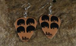Beatles guitar pick earrings Made from real guitar picks with hypoallergenic hooks Free shipping. Purchase at http://NatureCoastCreations.etsy.com
