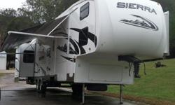 Here's a super nice 2008 Forest River Sierra 345QB 5th wheel!! If you are looking for a spacious, 5th wheel with enough room to sleep up to (10) people then you may want to check out this Sierra! This unit has (3) slide outs, dual A/C's, a bath and