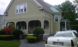 here is a solid 3 bedroom victorian home,,it has the charm of a real classic house orig oak floors,9ft ceilings,solid wood doors,oak grand staircase with rounded windows and banisters huge windows with all orig detailed wood work through