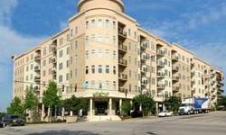 Beautiful condo at Adesso, priced to sell - only $290,000! Includes washer, dryer, refrigerator, wall mounted tv and speakers in living room, blinds and storage unit (with separate Tax I.D.) and 2 parking spaces in the garage. Seller will consider