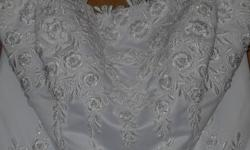 Beautiful Alfred Angelo Wedding Gown for sale. White w/white pearls & sequins detailed on dress. Flower-shaped spaghetti straps. Traditional style. $150 Bought brand new for $500. Still in Great shape! Email me for pictures. Pics dont do it justice.