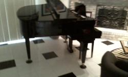 Beautiful TOKAI Baby Grand Piano well kept and would be a great addition to the decor in your home.