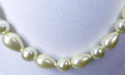 """Lovely white 1/2"""" oval lustrous white pearls combine with matching 1/4"""" round pearls to make this lovely necklace suitable for day or evening wear. The 21"""" length is closed with a labster claw clasp. Handmade original design is one-of-a-kind."""